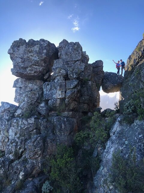 Hikers crossing the iconic venster (window) of India Venster, one of the best Table Mountain routes.